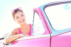 Woman driving vintage car - Retro style image of happy smiling young woman Kuvituskuvat
