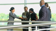 business male female multi ethnic city atrium wireless tablet property finance - stock footage