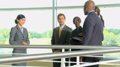 African American Caucasian Asian Chinese business office atrium wireless tablet - stock footage