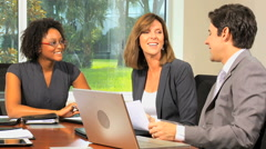 Caucasian African American male female business executive tablet laptop device - stock footage