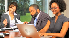 African American Caucasian male female business financial team laptop tablet - stock footage
