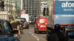 London street traffic tele shot Stock Footage
