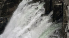 Loud waterfall in the Himalaya mountains, side view, medium shot Stock Footage