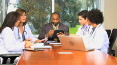 multi ethnic male female medical consultant financial planning laptop tablet - stock footage