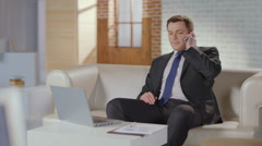 Stock Video Footage of CEO, boss making phone call. Luxury office, businessman at work