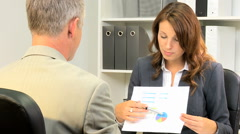 male female Western European business manager banking trader shares advertising - stock footage