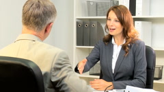 Handshake male female Western European business manager banking trader shares Stock Footage