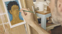 Artist painting a portrait,oil painting,creating the eyes Stock Footage
