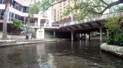 San Antonio River Flows Thru Texas City Downtown Riverwalk Stock Footage