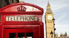 Red phone booth and Big Ben London telephone Stock Footage