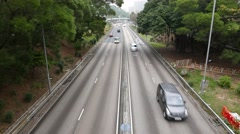 Road in forest, four lanes with divider, top perspective view Stock Footage