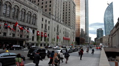 People walk between Union station and the Royal York hotel Stock Footage
