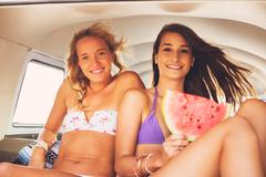 Surfer Girls Beach Lifestyle - stock photo