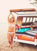 Surfer Girl Beach Lifestyle - stock photo