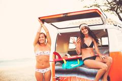 Surfer Girls Beach Lifestyle Stock Photos