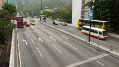 Left-hand drive viaduct road, view from above point, buses and cars Stock Footage