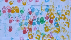 Close up of child's  color handprints painted on the wall in slow motion Stock Footage