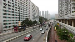 Viaduct beginning, road between high-rise buildings, dense bus traffic Stock Footage
