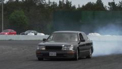 Drift car on race track in slow motion Stock Footage