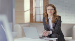 Beautiful businesswoman, office worker smiles pretty for camera Stock Footage
