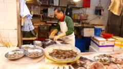 Variety of seafood products on market stall, close view Stock Footage
