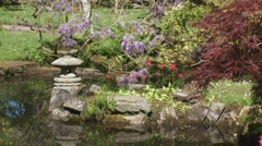 Stone Lantern in pond of historical Japanese Garden CLINGENDAEL, THE HAGUE Stock Footage