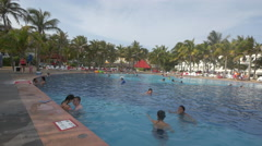Smiling and swimming in the pool at Grand Oasis Cancun Stock Footage