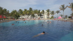 Swimming in the pool at Grand Oasis Cancun Stock Footage