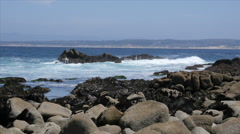Rocky Beach with Sailboat at Pacific Grove Point Pinos - stock footage