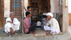 Indian men and boy sitting at porch of a house in Jodhpur. Stock Footage