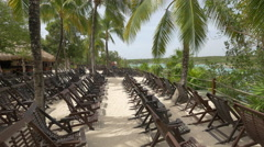 Wooden chairs near the beach at Xel-Ha Park, Mexico - stock footage