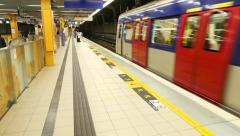 Empty metro platform, train arrive and stop at the station Stock Footage