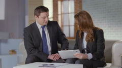 Man and woman discussing business matters in office, slow motion - stock footage