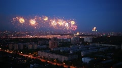 Residential area of city with fireworks during holiday at evening Stock Footage