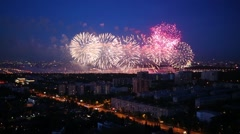 Residential district of city with fireworks at evening Stock Footage