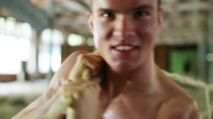 Face of young naked muscular man with rope. Shallow dof Stock Footage