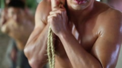 Four sweaty men pull ropes in abandoned building. Shallow dof Stock Footage