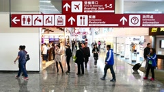 Modern airport hall and navigation signs, passengers and duty free zone Stock Footage