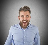 Aggressive businessman screams - stock photo