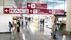 International airport directory signboard in motion, against duty free zone - stock footage