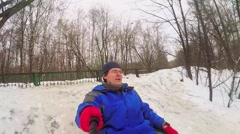 Man slides by snow slope at winter day. Slow motion selfie Stock Footage