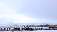 Visitors at the geyser eruption of Strokkur, Iceland in slow motion Stock Footage