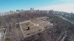 Cityscape with cemetery at spring sunny day. Aerial view Stock Footage