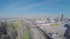 Cityscape with industrial zone at spring sunny day. Aerial view Stock Footage