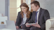Stock Video Footage of Businesswoman showing financial charts, presentation to client