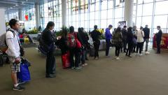 Boarding gate queue, people stand in line, slowly move to gate, parallax shot Stock Footage