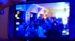 Using smart phone on a disco concert club as a shooting photo camera Stock Footage