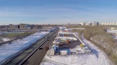 Road traffic near snow-smeltery and emergency control reservoir Stock Footage