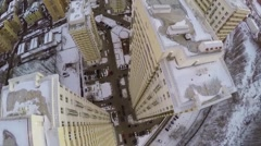 Residential complex and parked cars on street covered by snow Stock Footage