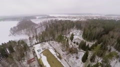 Territory of country club among trees on shore of Istra river Stock Footage